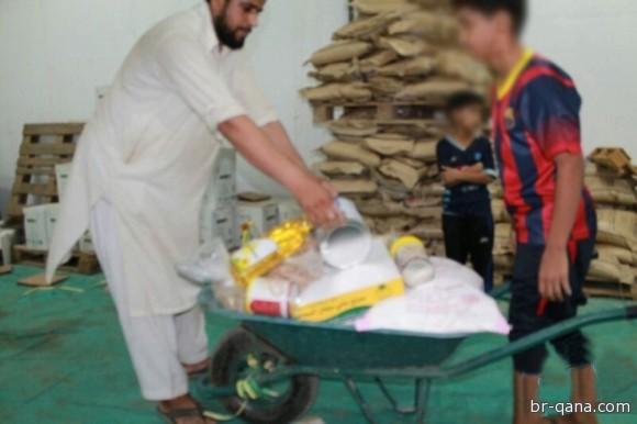 جمعية البر بقنا توزع سلال رمضان لـ500 أسرة